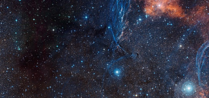 This colourful image shows the rich celestial landscape in the constellation of Vela (The Sails) around the aging double star IRAS 08544-4431, which appears as the moderately bright star at the exact centre of the picture. The image was created from images forming part of the Digitized Sky Survey 2. It also includes several other interesting unrelated objects. At the bottom the Pencil Nebula (NGC 2736) is visible, along with the orange clouds of star formation regions and the blue filaments of part of the Vela Supernova Remnant.