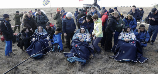 U.S. astronaut Kate Rubins, left, Russian cosmonaut Anatoly Ivanishin, center, and Japanese astronaut Takuya Onishi sit in  chairs shortly after the landing of the Russian Soyuz MS space capsule about 150 km (90 miles) southeast of the town of Dzhezkazgan,  Kazakhstan, Sunday, Oct. 30, 2016. A Russian Soyuz space capsule has landed in Kazakhstan, bringing back three astronauts from the United States, Japan and Russia back to Earth from a 115-day mission aboard the International Space Station. (AP Photo/Dmitri Lovetsky, pool)