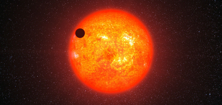 This artist's impression shows the super-Earth exoplanet GJ 1214b passing in front of its faint red parent star. This is the first super-Earth exoplanet to have had its atmosphere analysed. The exoplanet, orbiting a small star only 40 light-years away from us, has a mass about six times that of the Earth. GJ 1214b appears to be surrounded by an atmosphere that is either dominated by steam or blanketed by thick clouds or hazes.