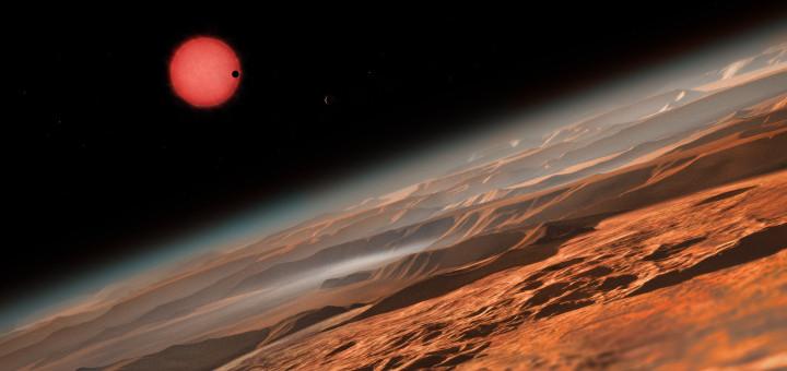 Вид ультра-холодной карликовой звезды TRAPPIST-1 из окрестностей одной из ее планет. Credit: ESO/M. Kornmesser